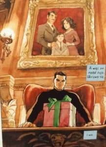 Batman Mroczny książę - Bruce patrzy na paczkę od Jokera, na niego patrzą z portretu rodzice